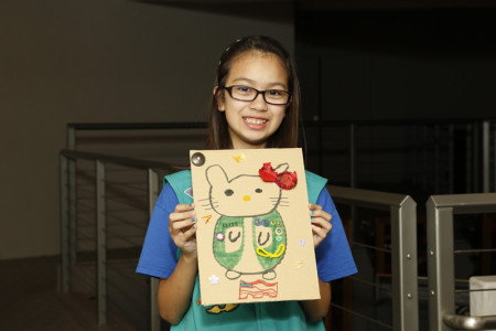 A Scout shows off her creation. Photo: Russell Kitagawa.