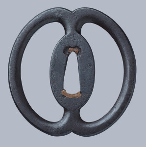 Musashi Miyamoto, tsuba with a design of two sea cucumbers, 1600s, iron.