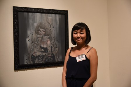 Artist Audrey Kawasaki poses in front of her artwork. Photo by Nobuyuki Okada.