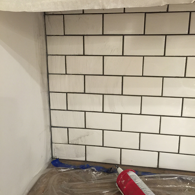 new laundry room subway tile grout