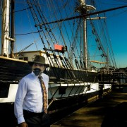 Filmmaker Arnon Shorr in front of The Brig Pilgrim at The Ocean Institute