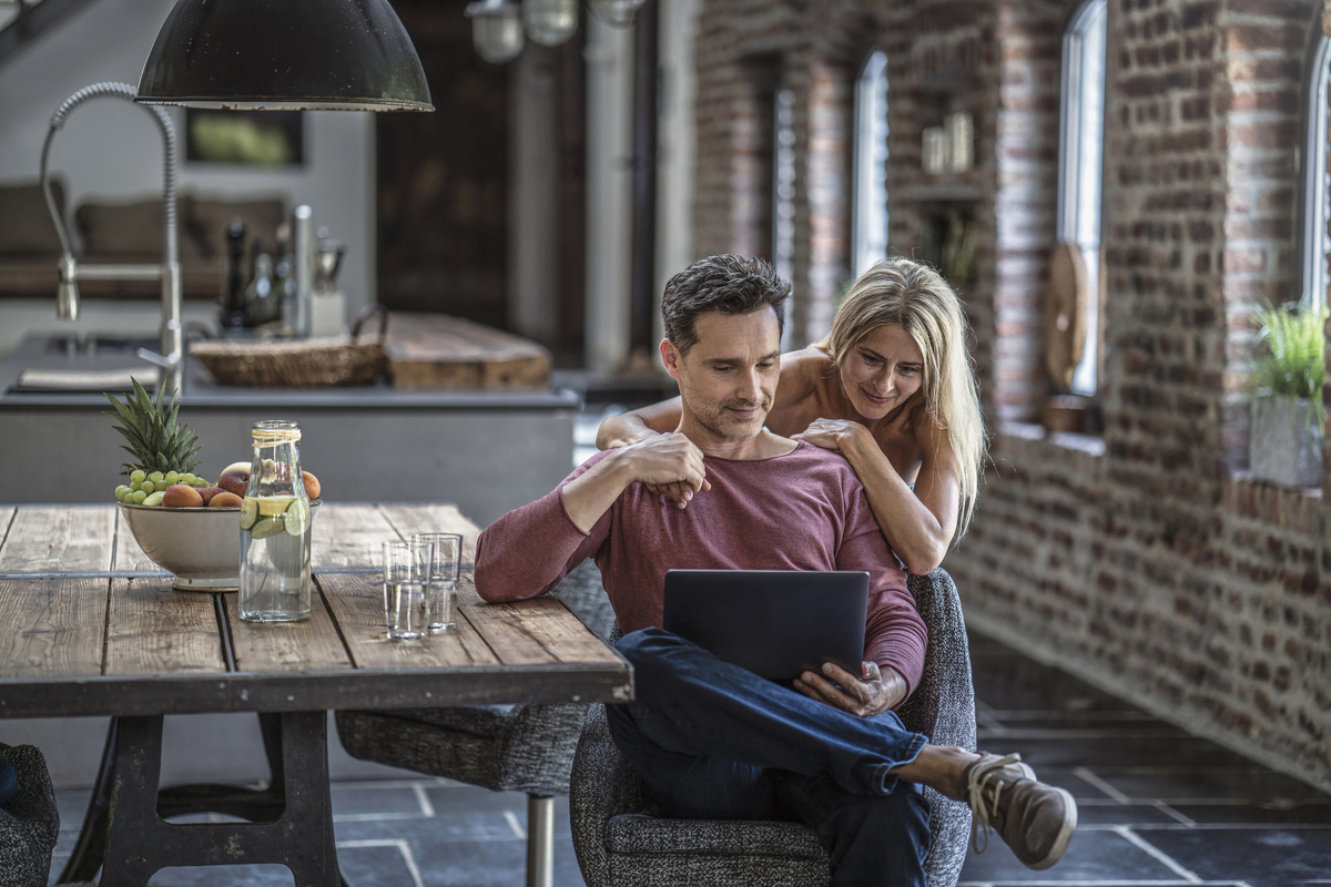 Couple reviewing Save investment returns