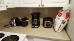 Nos exigences personnelles :D en ce qui me concerne, c'est la machine à café... Même si j'utiliserai très probablement le rice cooker de Greg assez souvent !