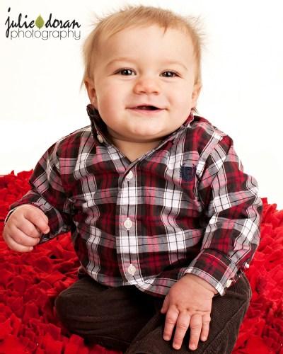big smile on red rug
