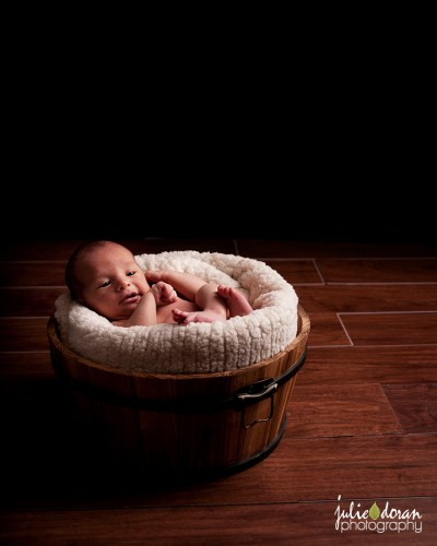 newborn_in_wooden_pail
