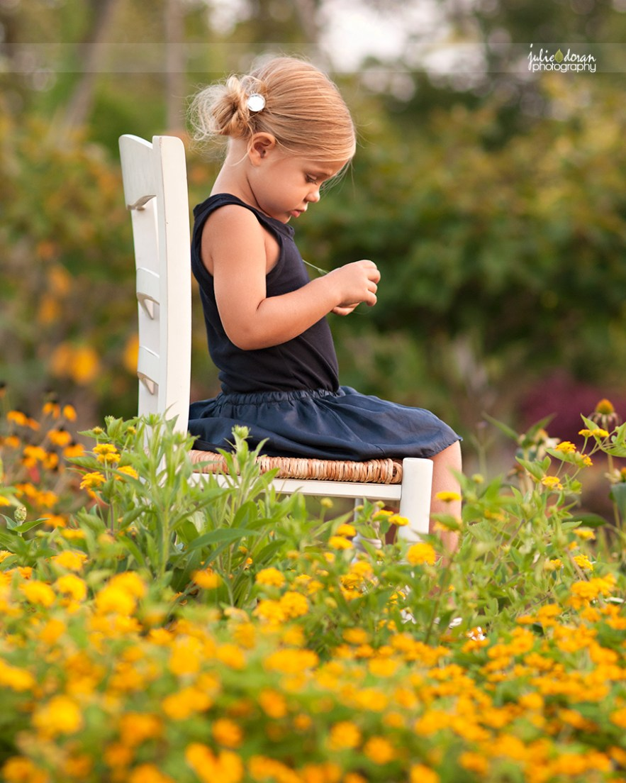 little pigtail girl on chair
