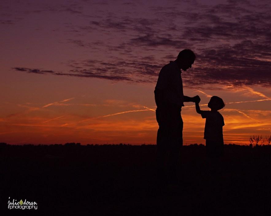 grandpa and grandson sunset