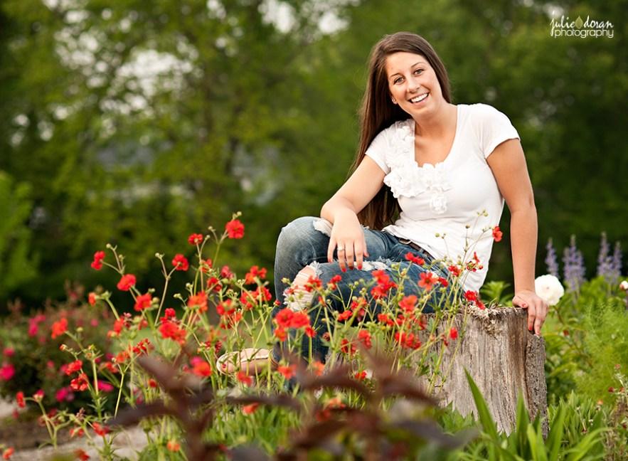 girl on tree stump