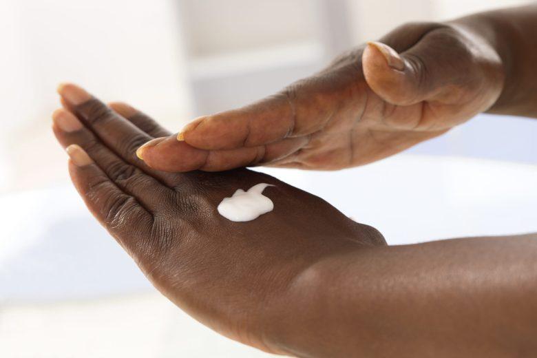 A woman moisturizing her hands