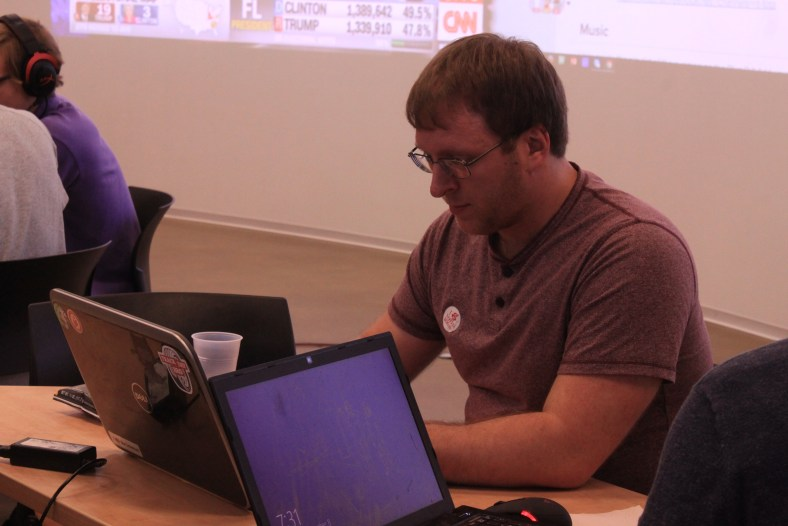 Mark Repka works on his 2016 Election Viewer app during the Election Night Hackathon by FOSS at RIT