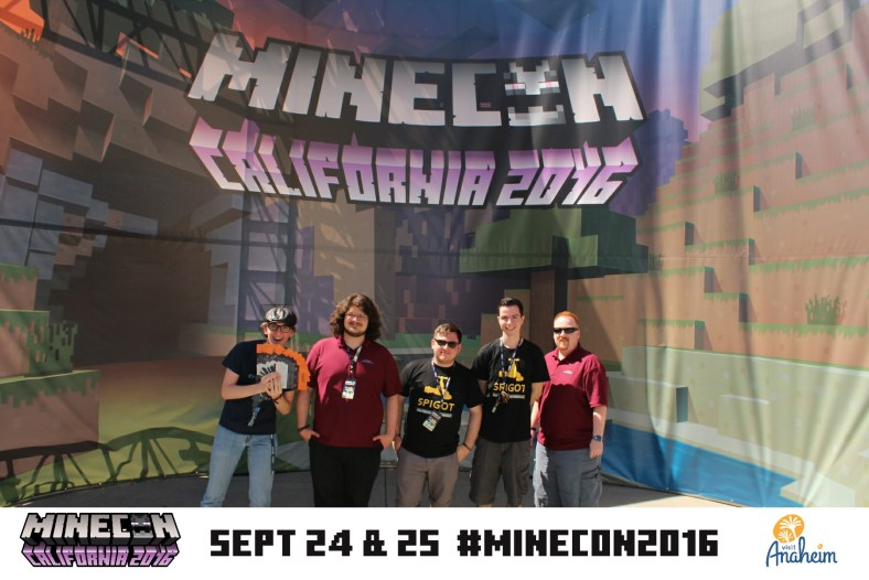 Some of the team poses in front of the big MINECON 2016 banner in Anaheim, California
