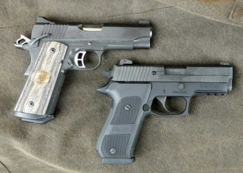Kimber and Sig Sauer pistol right profile