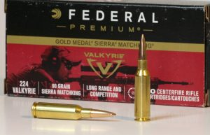 Federal 224 Valkyrie cartridges in front of an ammunition box