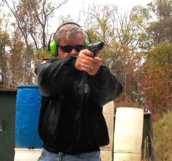 Bob Campbell shooting the Beretta M9 pistol