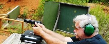 Bob Campbell firing syntech a pistol from a braced position