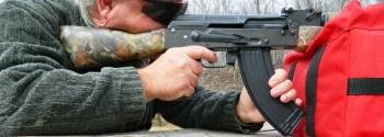 Bob Campbell shooting an AK-47 rifle