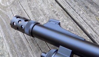 Muzzle breeching device on the Remington Model 870 Tactical Magpul shotgun