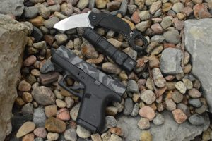 Extrema Ratio Nightmare Karambit with Glock and flashlight
