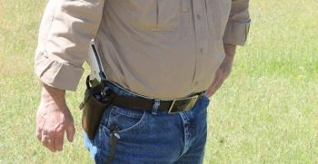 Man openly carrying a revolver in a holster for Constitutional Carry
