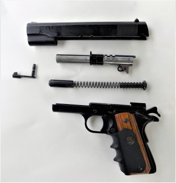 fieldstripped Regent R100 1911 handgun