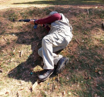 Man firing an Arsenal AK-47 from a prone position