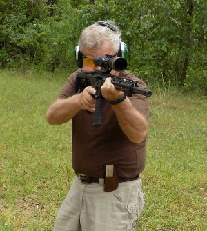 Bob Campbell shooting an AR-15 from an offhand position for rifle marksmanship