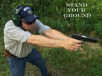 Dave Dolbee in a combat stance with a Nighthawk pistol for Armed Good Guys