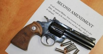 Revolver atop a copy of the Second Amendment