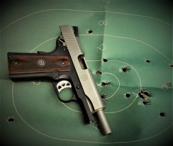 Ruger SR1911 Commander on a green silhouette target
