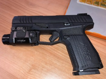 Arex Rex Delta pistol with tactical light