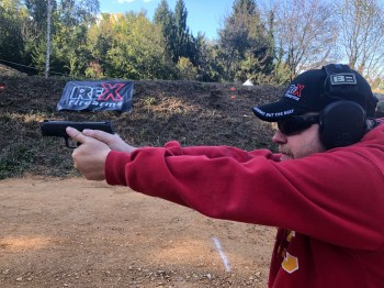 Dave Dolbee firing the Arex Rex Delta pistol.