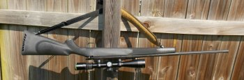 Mossberg ATR rifle hanging upside down by the sling