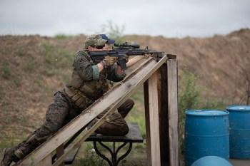 Shooter laying on an angled barricade