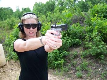 Woman shooting a Browning Hi-Power pistol
