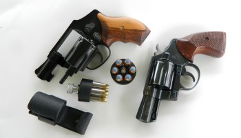 Two snubnose .38 revolvers with speedloaders