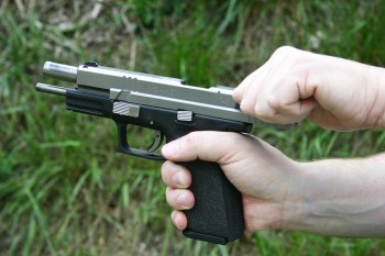Racking the slide of pistol