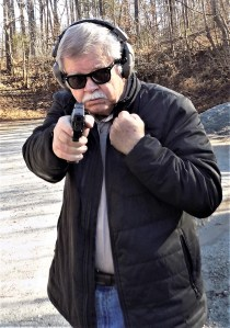 bob Campbell shooting a pistol one handed