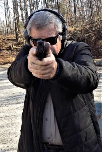 Bob Campbell shooting a pistol two handed