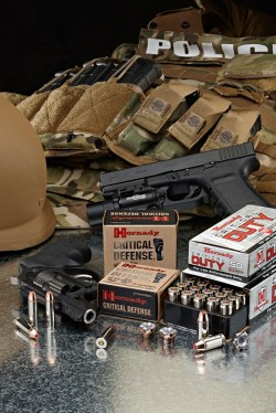 Flack vest, pistol, revolver, and Hornady Critical Duty ammunition box