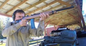 Robert Sadowski shooting a M1 Carbine rifle at an outdoor shooting range