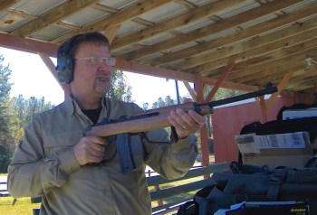 Robert sadowski shooting a M1 carbine rifle with the stock in the folded position