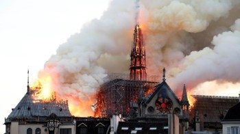 Smoke billows as fire engulfs the spire of Notre Dame Cathedral in Paris, France