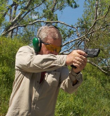 Bob Campbell quickly drawing and firing a pistol