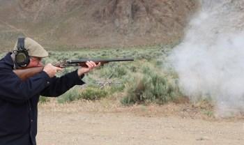 Jeff John shooting a side by side shotgun with black powder loads
