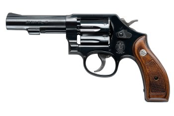 Classic Smith and Wesson Military and Police .38 Special, left profile with wood grip