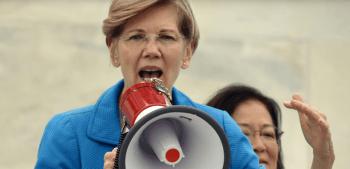 Senator Elizabeth Warren talking through a megaphone speaking about gun control