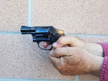 Smith and Wesson Centennial revolver held with a two handed grip