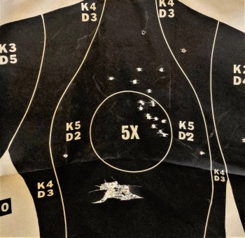 Silhouette target littered with buckshot holes