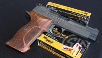 Two boxes of SIG Sauer ammunition under a handgun