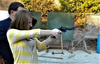 Young woman shooting the Smith and Wesson Combat Magnum revolver